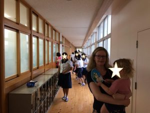 The author and her son at her main school, 11 years post-JET
