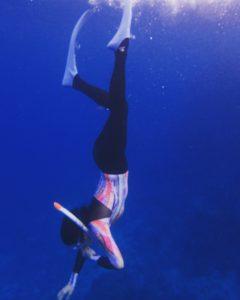 person scuba diving
